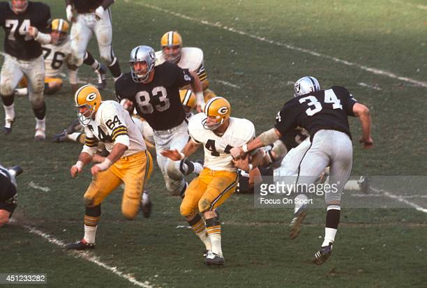 January 14: Donny Anderson of the Green Bay Packers runs through the tackle of Gus Otto of the Oakland Raiders during Super Bowl II January 14, 1968...