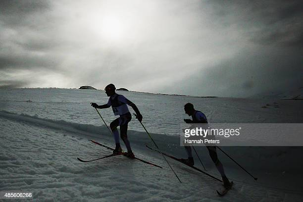 Donny Boake of Canada and William Poffenroth of Canada compete in the FIS CrossCountry Skiing ANC Mass Start Classic Mens race during the Winter...