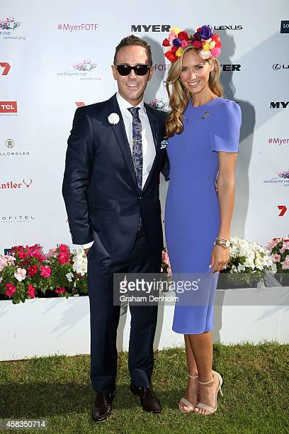 Donny Galella and Nikki Phillips pose in the Fashion on the Field enclosure on Melbourne Cup Day at Flemington Racecourse on November 4 2014 in...