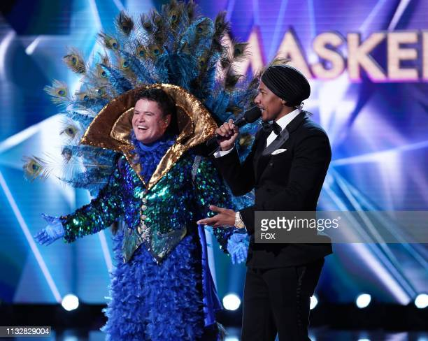 Donny Osmond and host Nick Cannon in the special twohour Road to the Finals / Season Finale The Final Mask is Lifted season finale episode of THE...