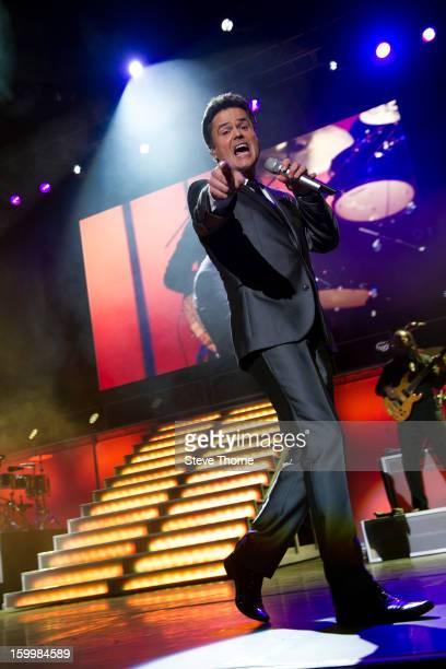 Donny Osmond performs on stage in concert at LG Arena on January 24, 2013 in Birmingham, England.