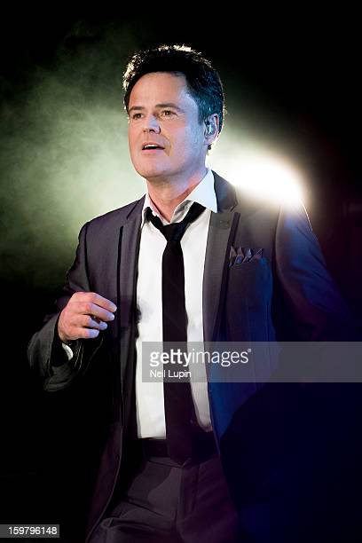 Donny Osmond performs on stage in concert with Marie Osmond at O2 Arena on January 20 2013 in London England