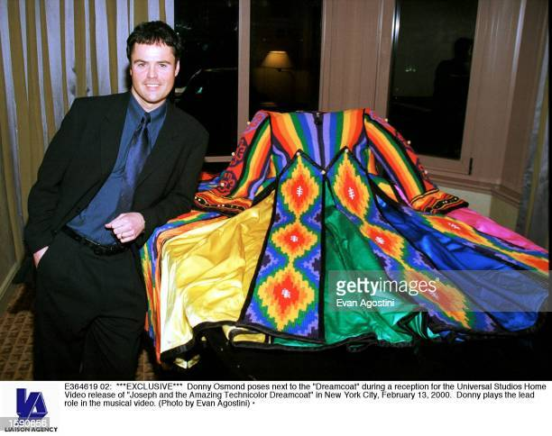 """Donny Osmond poses next to the """"Dreamcoat"""" during a reception for the Universal Studios Home Video release of """"Joseph and the Amazing Technicolor..."""