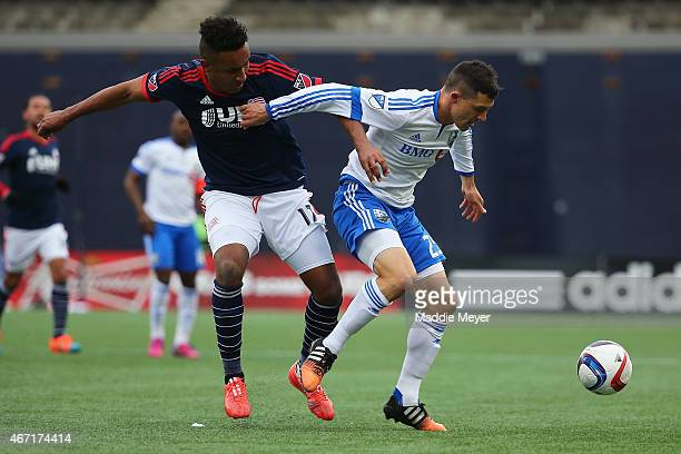 Donny Toia of Montreal Impact shields the ball from Kelyn Rowe of New England Revolution during the second half at Gillette Stadium on March 21 2015...