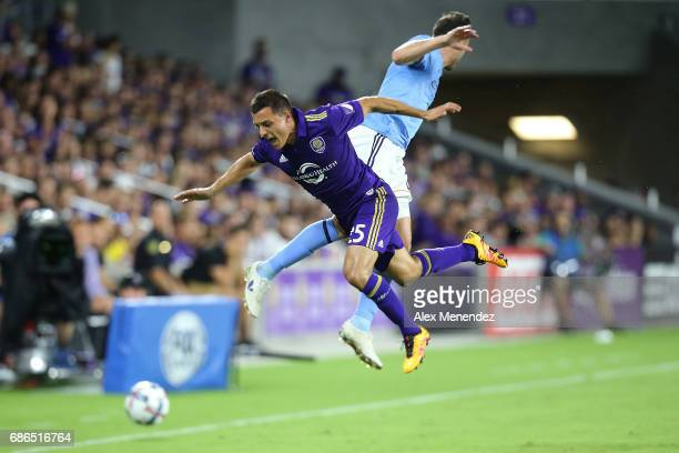 Donny Toia of Orlando City SC and RJ Allen of New York City FC collide in the air during a MLS soccer match between New York City FC and the Orlando...
