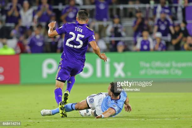 Donny Toia of Orlando City SC gets tackled by RJ Allen of New York City FC during a MLS soccer match between New York City FC and Orlando City SC at...