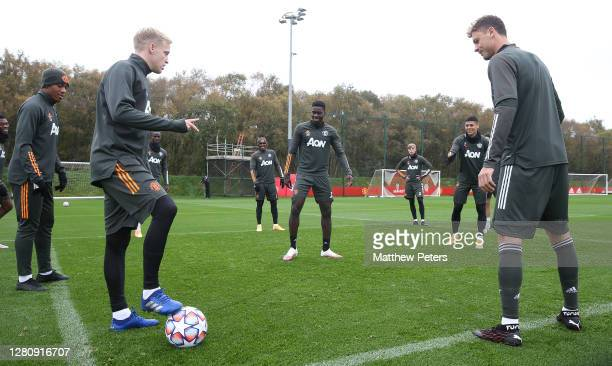 Donny van de Beek Axel Tuanzebe and Nemanja Matic of Manchester United in action during a first team training session at Aon Training Complex on...