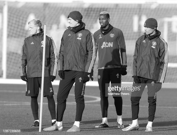Donny van de Beek, Harry Maguire, Paul Pogba, Mason Greenwood of Manchester United in action during a first team training session ahead of the UEFA...