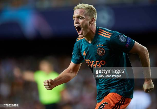 Donny van de Beek of AFC Ajax celebrates scoring his team's third goal during the UEFA Champions League group H match between Valencia CF and AFC...