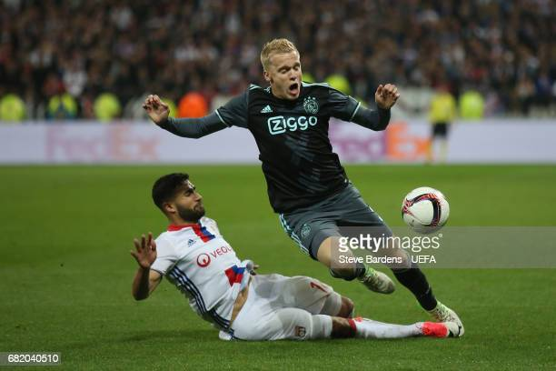 Donny van de Beek of Ajax Amsterdam is tackled by Nabil Fekir of Olympique Lyonnais during the Uefa Europa League semi final second leg match between...
