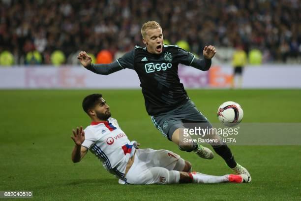 Donny van de Beek of Ajax Amsterdam is tackled by Nabil Fekir of Olympique Lyonnais during the Uefa Europa League, semi final second leg match,...