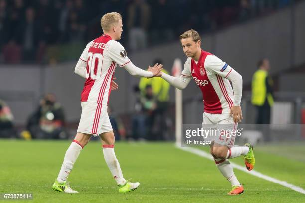 Donny van de Beek of Ajax Amsterdam shakes hands with Frenkie de Jong of Ajax Amsterdam during the UEFA Europa League Quarter Final first leg match...
