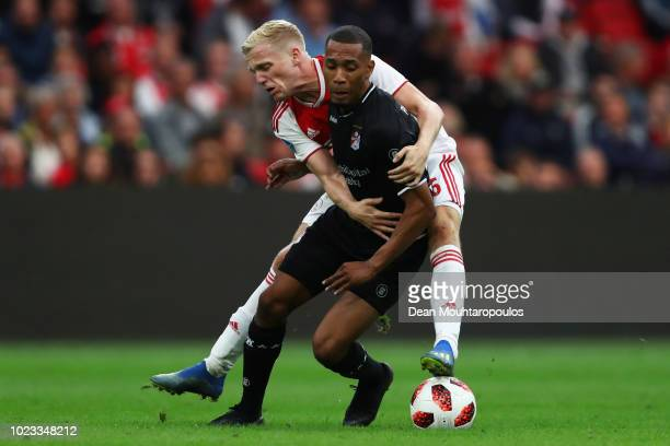 Donny van de Beek of Ajax battles for the ball with Michael Chacon of FC Emmen VV during the Eredivisie match between Ajax and Emmen at Johan Cruyff...