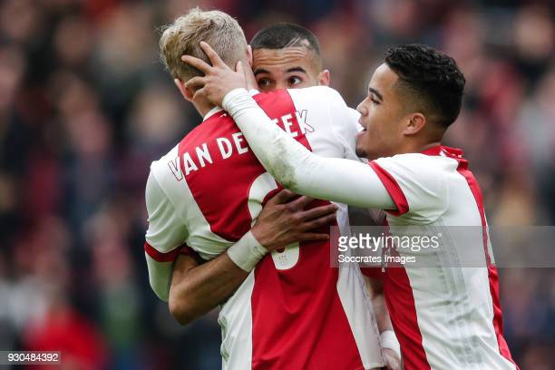 Donny van de Beek of Ajax celebrate his goal the 31 with Hakim Ziyech of Ajax Justin Kluivert of Ajax during the Dutch Eredivisie match between Ajax...