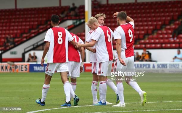 Donny van de Beek of Ajax celebrates 01 with Noussair Mazraoui of Ajax Frenkie de Jong of Ajax Klaas Jan Huntelaar of Ajax during the Club Friendly...