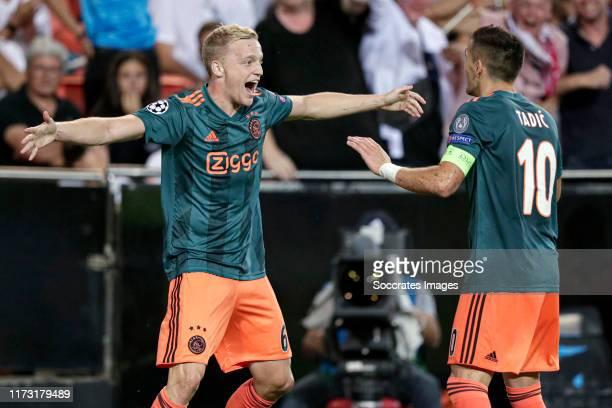 Donny van de Beek of Ajax celebrates 03 with Dusan Tadic of Ajax during the UEFA Champions League match between Valencia v Ajax at the Estadio de...