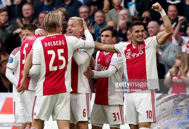 Donny van de Beek of Ajax celebrates 10 with Kasper Dolberg of Ajax Nicolas Tagliafico of Ajax Dusan Tadic of Ajax during the Dutch Eredivisie match...