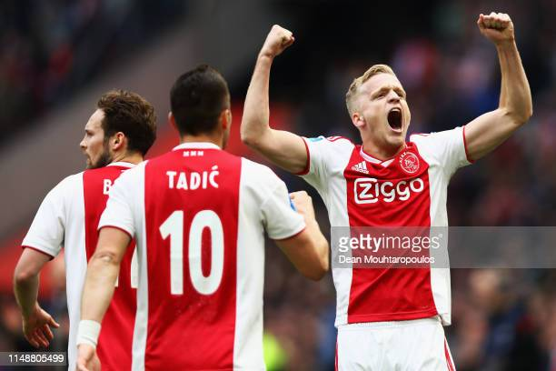 Donny van de Beek of Ajax celebrates scoring his teams second goal of the game with Daley Blind and Dusan Tadic during the Dutch Eredivisie match...