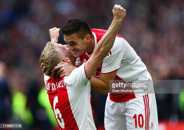 Donny Van de Beek of Ajax celebrates with his team mate Dusan Tadic after scoring his team's second goal during the Eredivisie match between Ajax and...