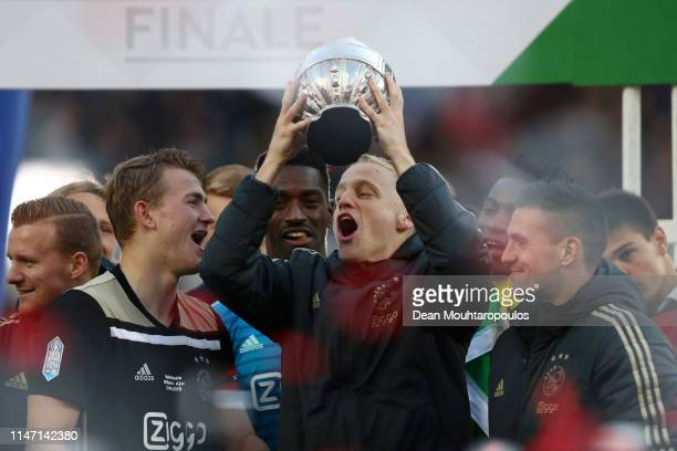 Donny van de Beek of Ajax celebrates with the trophy following the Dutch Toto KNVB Cup Final between Willem II and Ajax at De Kuip on May 05 2019 in...