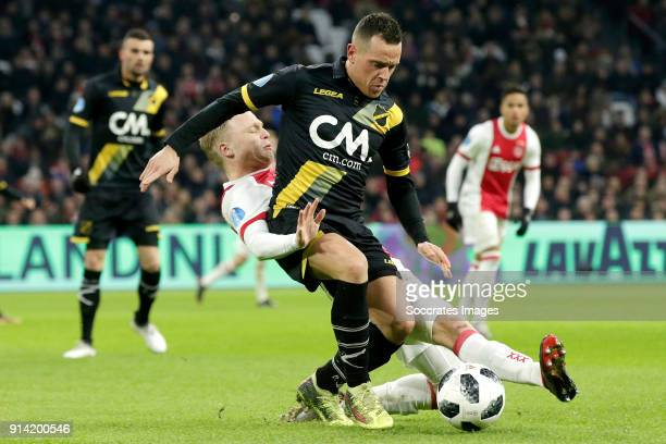 Donny van de Beek of Ajax Giovanni Korte of NAC Breda during the Dutch Eredivisie match between Ajax v NAC Breda at the Johan Cruijff Arena on...