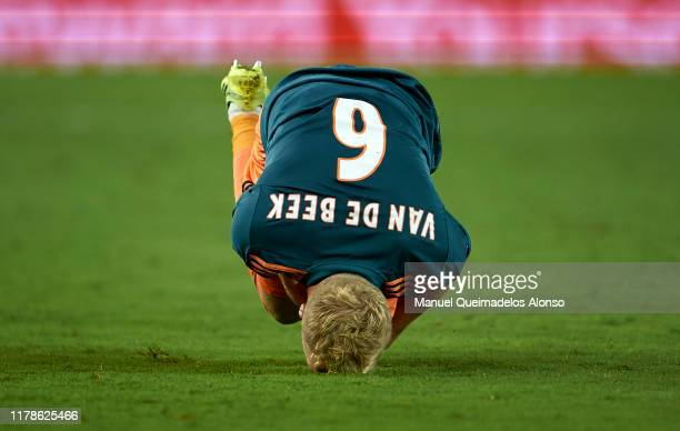 Donny van de Beek of Ajax lies injured on the pitch during the UEFA Champions League group H match between Valencia CF and AFC Ajax at Estadio...