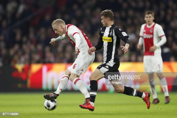 Donny van de Beek of Ajax Mickael Cuisance of Borussia Monchengladbach during the international friendly match between Ajax Amsterdam and Borussia...