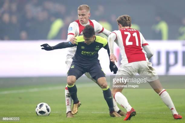 Donny van de Beek of Ajax Santiago Arias of PSV Frenkie de Jong of Ajax during the Dutch Eredivisie match between Ajax v PSV at the Johan Cruijff...
