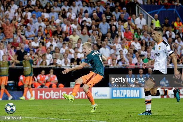 Donny van de Beek of Ajax scores the third goal to make it 03 during the UEFA Champions League match between Valencia v Ajax at the Estadio de...