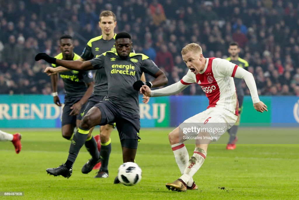 Donny van de Beek of Ajax scores the third goal to make it 3-0 during the Dutch Eredivisie match between Ajax v PSV at the Johan Cruijff Arena on December 10, 2017 in Amsterdam Netherlands