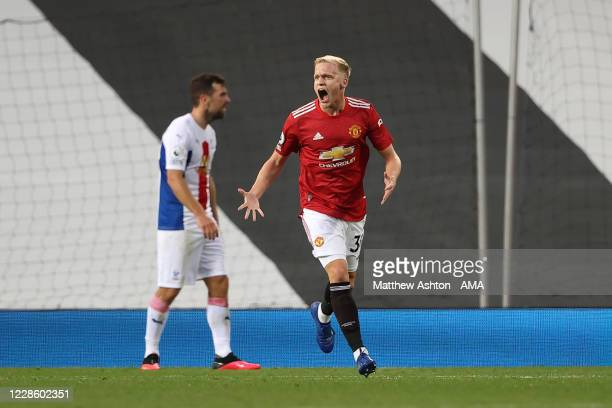 Donny van de Beek of Manchester United celebrates after scoring a goal to make it 12 during the Premier League match between Manchester United and...