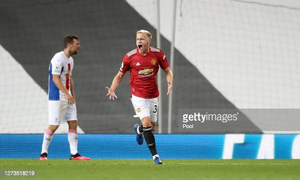 Donny Van De Beek of Manchester United celebrates after scoring his team's first goal during the Premier League match between Manchester United and...