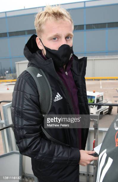 Donny van de Beek of Manchester United checks in ahead of their flight to Paris at Manchester Airport on October 19 2020 in Manchester England