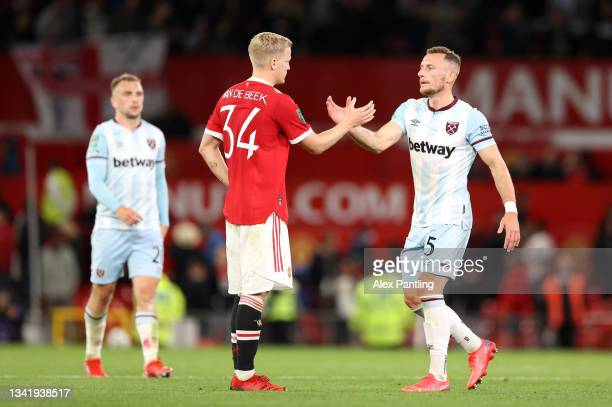 Donny van de Beek of Manchester United embraces Vladimir Coufal of West Ham United after the Carabao Cup Third Round match between Manchester United...