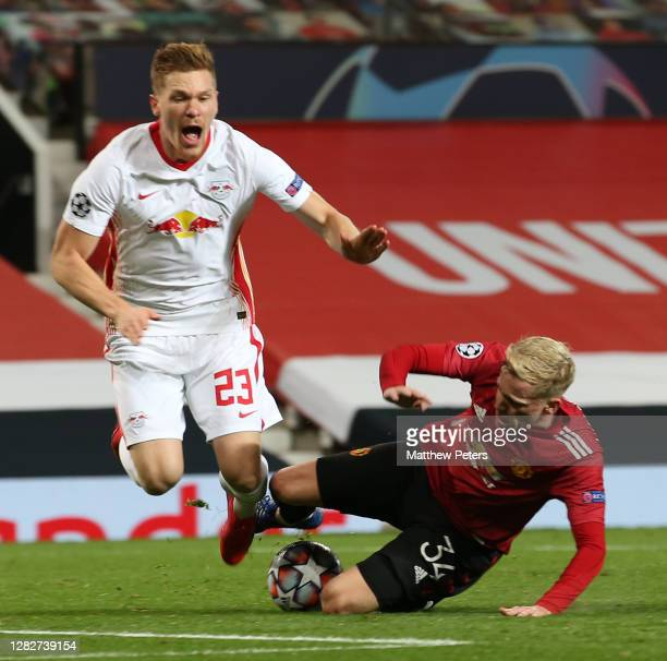 Donny van de Beek of Manchester United in action with Marcel Halstenberg of RB Leipzig during the UEFA Champions League Group H stage match between...