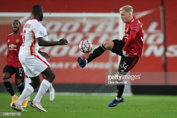 Donny Van De Beek of Manchester United is challenged by Dayot Upamecano of RB Leipzig during the UEFA Champions League Group H stage match between...