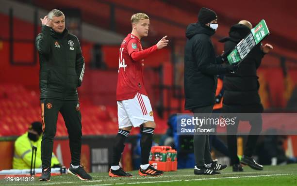 Donny van de Beek of Manchester United is substituted on the pitch for Fred of Manchester United during the Carabao Cup Semi Final match between...