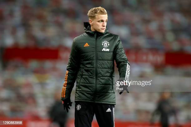 Donny Van De Beek of Manchester United looks on during the warm up prior to the Premier League match between Manchester United and Manchester City at...