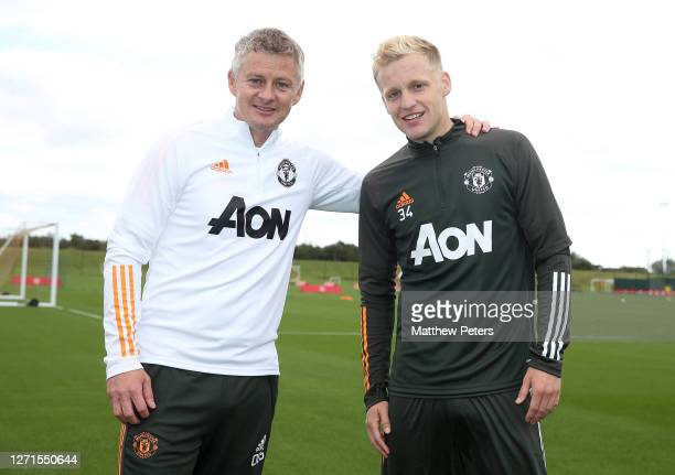 Donny van de Beek of Manchester United poses with Manager Ole Gunnar Solskjaer after a first team training session at Aon Training Complex on...