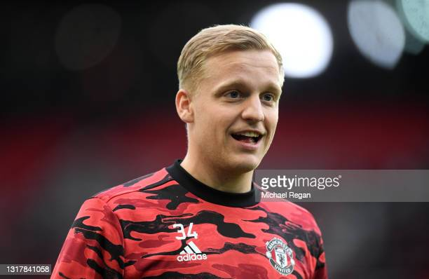 Donny van de Beek of Manchester United reacts as he warms up prior to the Premier League match between Manchester United and Liverpool at Old...