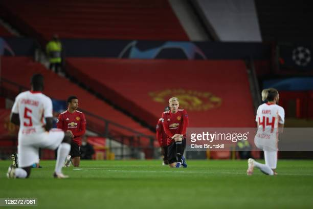 Donny Van De Beek of Manchester United takes a knee in support of the Black Lives Matter movement prior to the UEFA Champions League Group H stage...