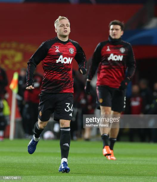 Donny van de Beek of Manchester United warms up ahead of the UEFA Champions League Group H stage match between Manchester United and RB Leipzig at...