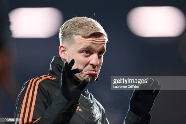 Donny van de Beek of Manchester United warms up prior to the Premier League match between Manchester United and Sheffield United at Old Trafford on...