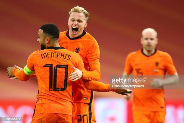 Donny van de Beek of Netherlands celebrates scoring his teams first goal of the game with team mate Memphis Depay during the international friendly...
