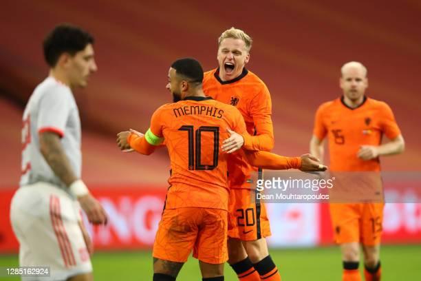 Donny van de Beek of Netherlands celebrates with teammate Memphis Depay of Netherlands after scoring their sides first goal during the international...