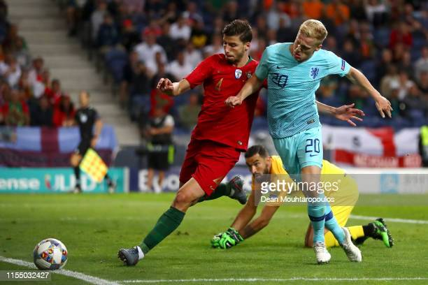 Donny van de Beek of The Netherlands battles for the ball with Ruben Dias of Portugal during the UEFA Nations League Final between Portugal and the...