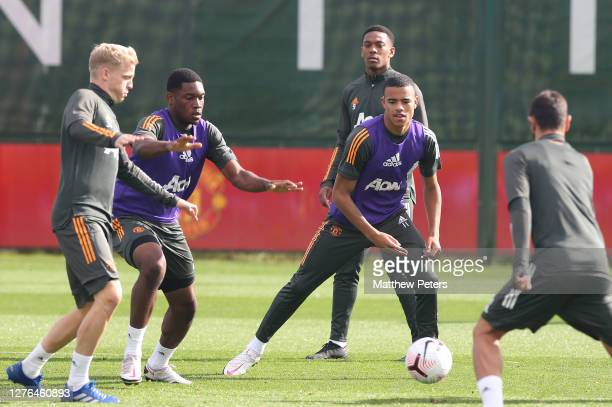 Donny van de Beek Teden Mengi Mason Greenwood Anthony Martial of Manchester United in action during a first team training session at Aon Training...
