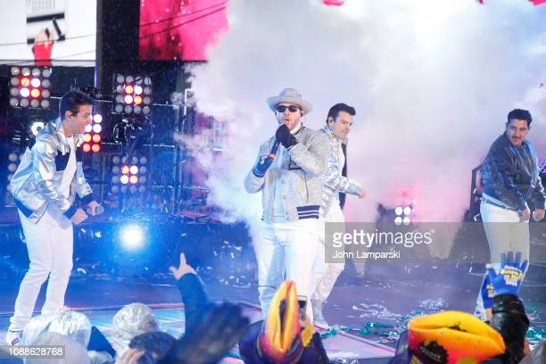 Donny Wahlberg Jordan Knight Joey McIntyre and Danny Wood of the New Kids on the Block as they perform during the Times Square New Year's Eve 2019...