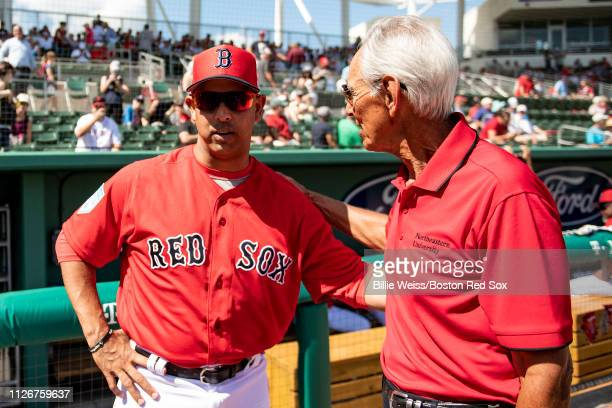 Donor Amin Khoury of the Northeastern University greets Boston Red Sox manager Alex Cora before throwing out a ceremonial first pitch before a game...