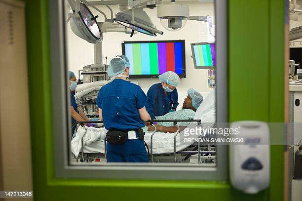 A donor is prepared in an operating room before a kidney transplant at Johns Hopkins Hospital June 26 2012 in Baltimore Maryland Doctors from Johns...